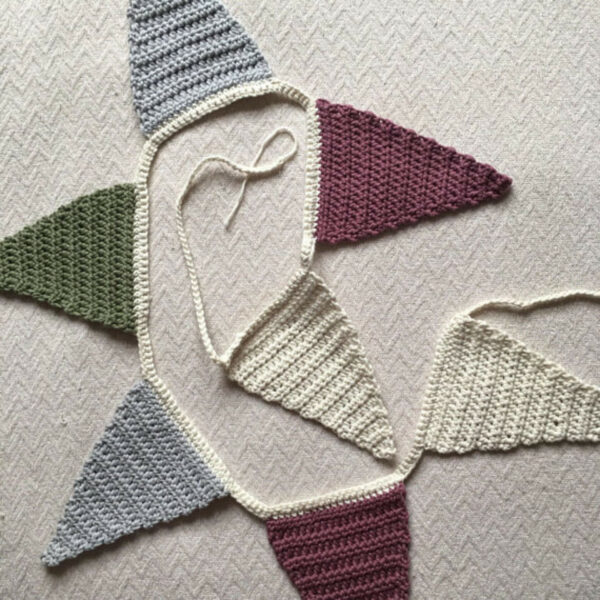 7 Triangle Crochet Bunting In Cream, Pink, Grey and Green