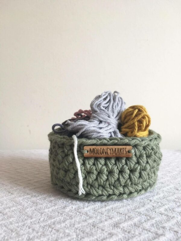 small crochet pot in moss green by Moloneymakes