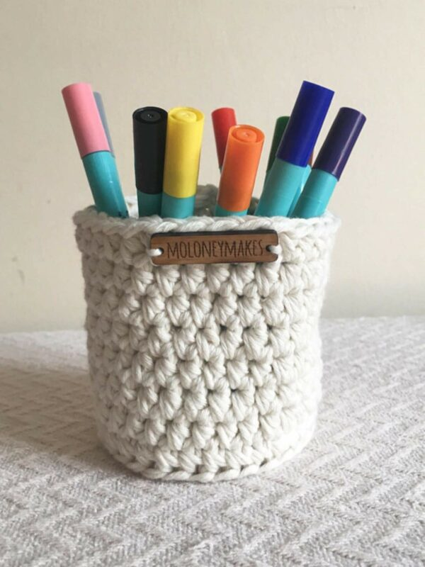 Tall crochet pot with pens by Moloneymakes