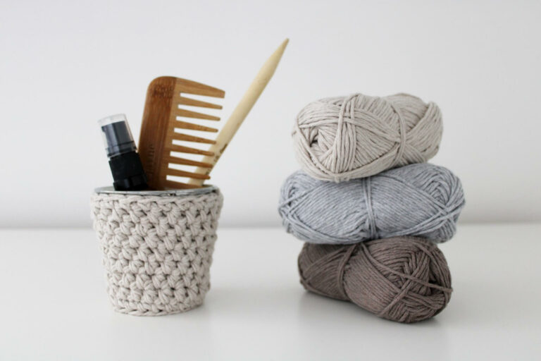 Stack of recycled cotton yarn with mini crochet pot