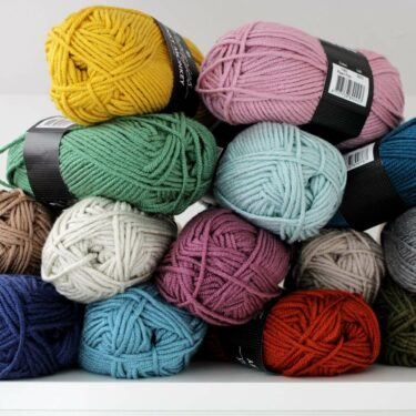 Bundle of scheepjes chunky monkey yarn in a variety of colours