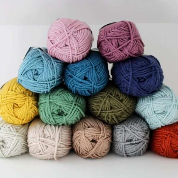 Pyramid stack of scheepjes chunky monkey yarn in a variety of colours