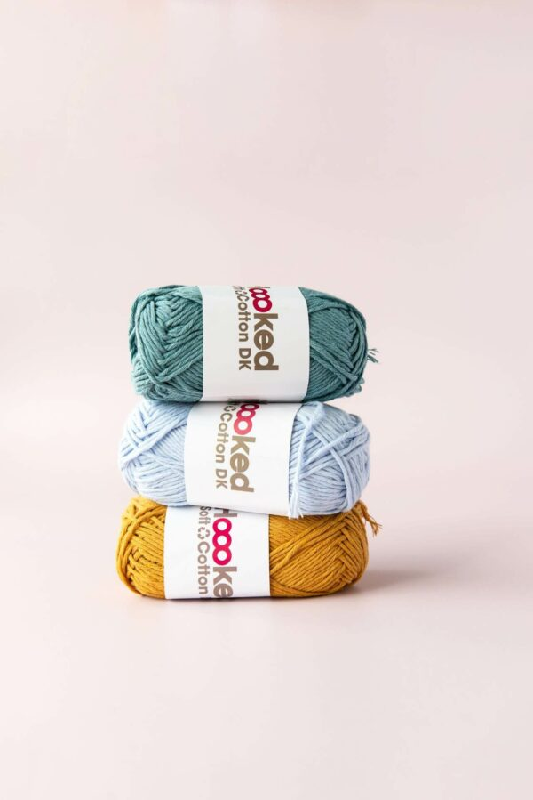 stack of 3 balls of hoooked recycled cotton dk in teal, light blue and mustard