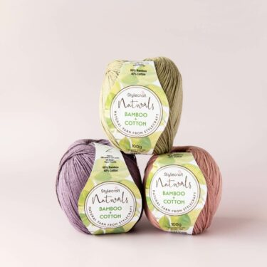stack of 3 balls of stylecraft naturals bamboo and cotton in thyme, raisin and cameo