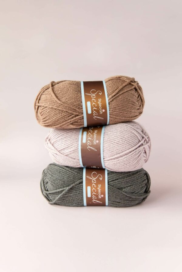 stack of 3 balls of stylecraft special chunky in mushroom, mocha and graphite