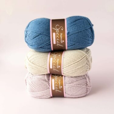 stack of 3 balls of stylecraft special dk in petrol, parchment and mushroom
