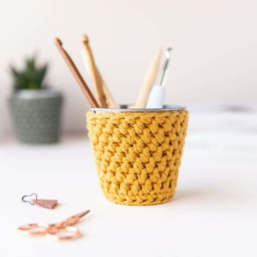 mini crochet pot in mustard with crochet hooks