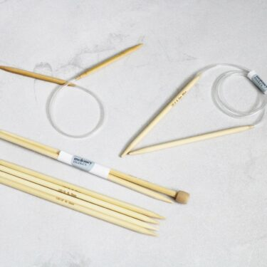 A collection on 6mm Knitting Needles on a grey background
