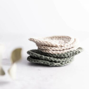 stack of crochet face scrubbies in khaki and sand