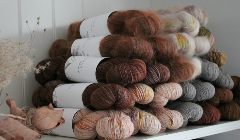 skeins of hand dyed yarn (probably from an independent craft shop on white shelves taken by nynne schroder
